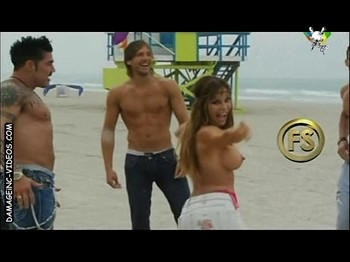 Graciela Alfano topless at the beach
